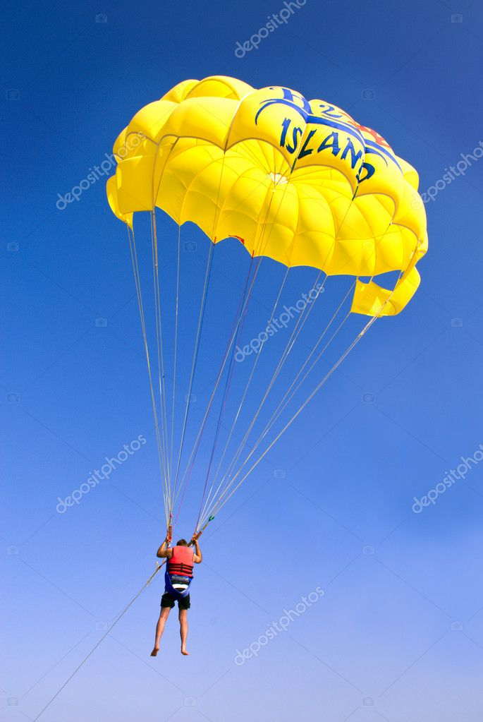 Parachutist with a yellow parachute.  Stock Photo #4205960