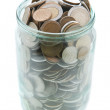 Money in glass jar on white background — Stock Photo