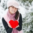 Teen girl heart in his hands — Stock Photo