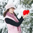 Teen girl heart in his hands — Stock Photo #4751751