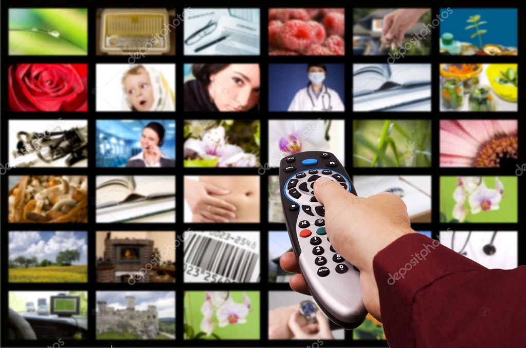 Close up of a hand holding a remote control with a television concept. — Stock Photo #4925508