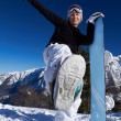 Stock Photo: Female Snowboarder in Dolomites