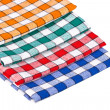 Four colored kitchen towels isolated — Stock Photo