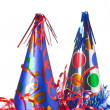 Party hats, streamers and confetti — Stock Photo