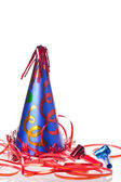 Party hat, blowers and ribbons — Stock Photo