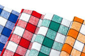 Quattro strofinacci colorati isolati — Foto Stock