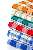 Many colored kitchen towels isolated — Stock Photo