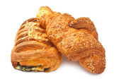 Croissant with sesame seeds and bun with cheese and spinach — Stock Photo