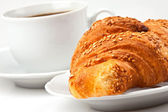 Breakfast: coffee and croissant with sesame seeds — Stock Photo