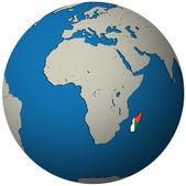 Madagascar flag on globe map — Stock Photo