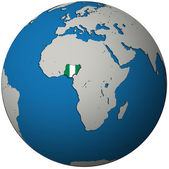Nigeria flag on globe map — Stock Photo