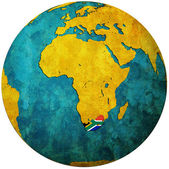 South africa flag on globe map — Stock fotografie
