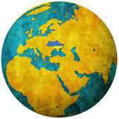Ukraine flag on globe map — Stock Photo