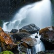 Stock Photo: Small waterfall with moss rocks.