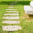 Stone walkway and stone bench — Stock Photo