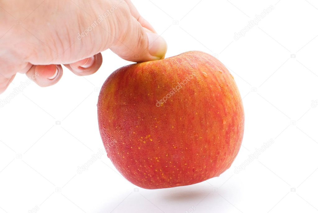 The hand is taking the apple away. Isolated with white background. — Stock Photo #3980939