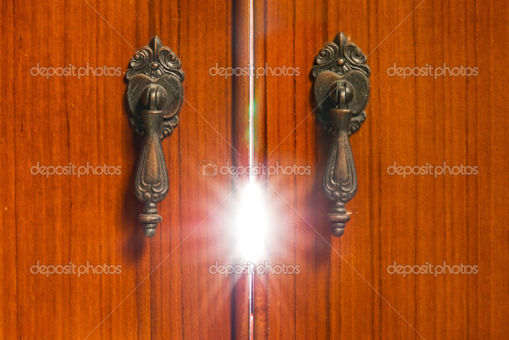 Mystery light from the wooden cabinet. Mystery concept.  Stockfoto #3982778