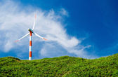 Wind turbine in green hill — Stock Photo