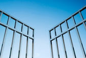 Iron gate open to the sky — Stock Photo