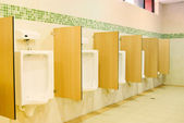 Modern restroom interior with urinal row — Stock Photo