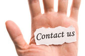 Contact us, word in hand — Stock Photo