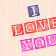 Stock Photo: I love you, words stamped on wooden background.