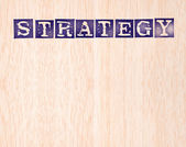 Strategy word stamped on wooden background. words collection series. — Stock Photo