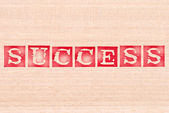 Success word stamped on wooden background. words collection series. — Stock Photo