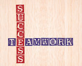 Success and teamwork word stamped on wooden background. words collection se — Stock Photo
