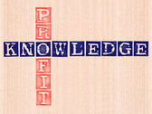 Knowledge and profit word stamped on wooden background. — Stock Photo