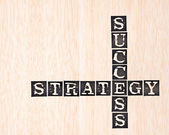 Success and strategy word stamped on wooden background — Stock Photo