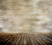 Grunge wall and wood paneled floor — Stock Photo