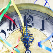 Antique clock with New Year ribbons — Stock Photo #4383992