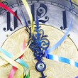 Antique clock with New Year ribbons — Stock Photo