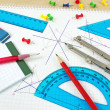 Stock Photo: Geometry equipment on writing desk