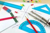 Geometry equipment on writing desk — Stock Photo