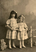 Vintage photo - little sisters. — Stock Photo