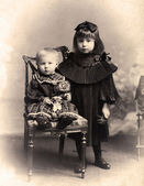 Vintage photo - little Sister and brother. — Stock Photo