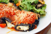 Baked eggplant filled with tomato and cheese — Stock Photo