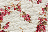 White cloth with pattern of flowers — Stock Photo