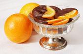 Delicious slices of orange coated chocolate — Stock Photo