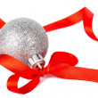 Christmas silver ball with red ribbon — Stock Photo