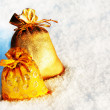 Gift sacks on a white snow — Stock Photo #4411288