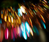 Background of defocused colored lights — Stock Photo