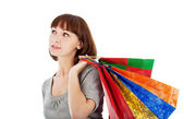 Pensive woman with shopping bags — Stock Photo