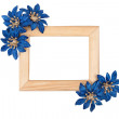 Wooden photo frame with blue flowers — Stock Photo
