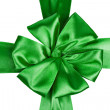 Green satin ribbon with bow — Stock Photo
