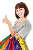 Vrouw met boodschappentassen haar duimen make-up — Stockfoto