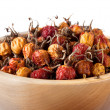 Dried rosehips in wooden bowl — Stock Photo