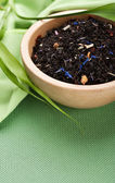 Dried black tea in bowl — Stock Photo